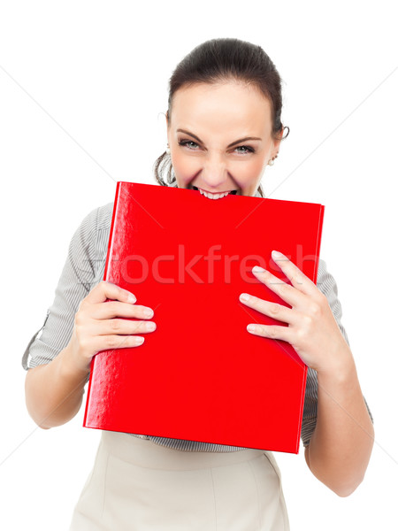 business woman bites in a red binder Stock photo © magann