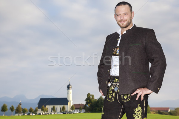 bavarian tradition man with a church in the background Stock photo © magann