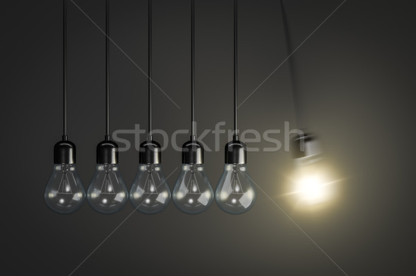 Pendulum of light bulbs Stock photo © magann