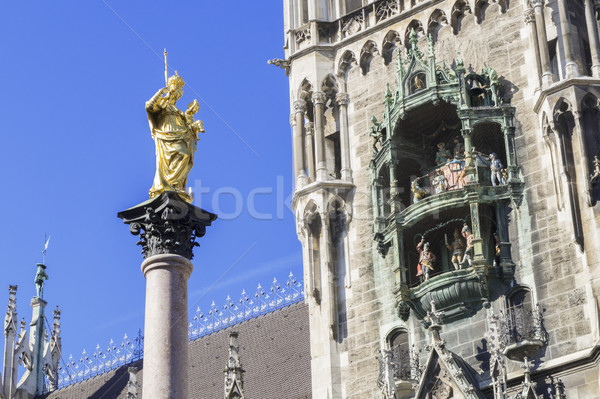 the golden Maria statue in Munich with the city hall Stock photo © magann