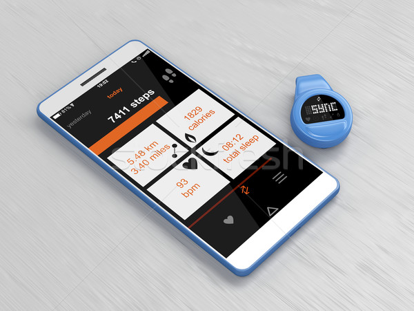 Activity tracker and smartphone  Stock photo © magraphics