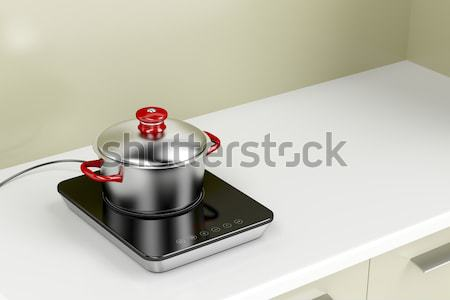 Preparing food on induction cooktop Stock photo © magraphics