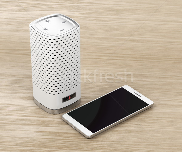 Speaker and smartphone on wood background Stock photo © magraphics