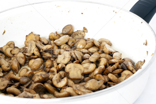 Fried mushrooms in pan Stock photo © magraphics