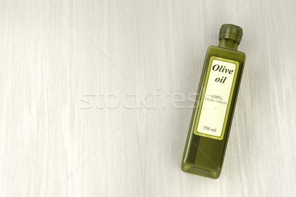 Aceite de oliva botella madera extra virgen mesa de madera Foto stock © magraphics