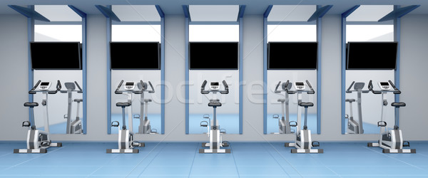 Stationary bicycles in gym Stock photo © magraphics