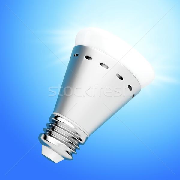 LED bulb on blue background Stock photo © magraphics