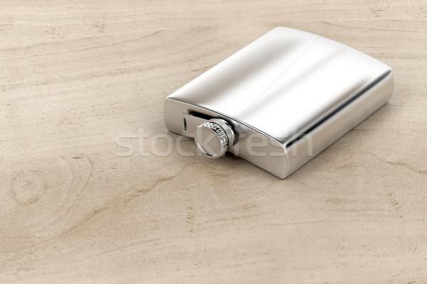 Ezüst csípő flaska fa asztal ital üveg Stock fotó © magraphics