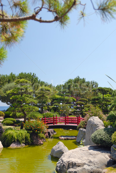 Stock photo: Japanese red bridge in zen garden