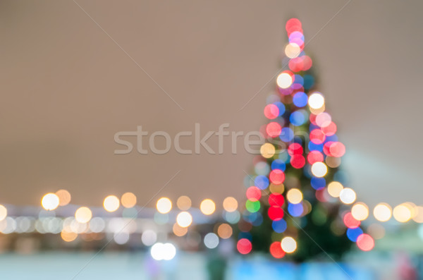 Defocused christmas tree silhouette with lights Stock photo © mahout