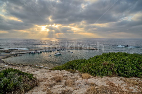 Vissen boten zonnestralen zee strand wolken Stockfoto © mahout