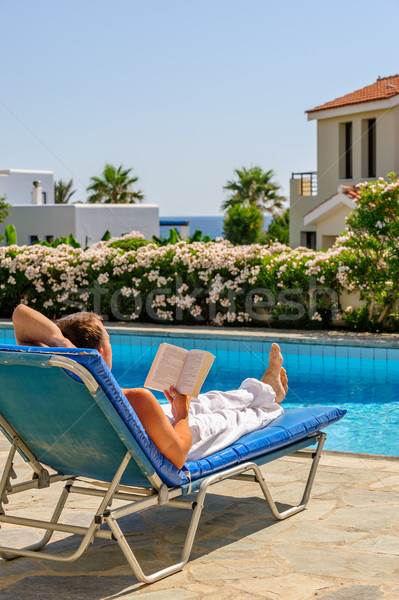 Man read book on deck chair Stock photo © mahout