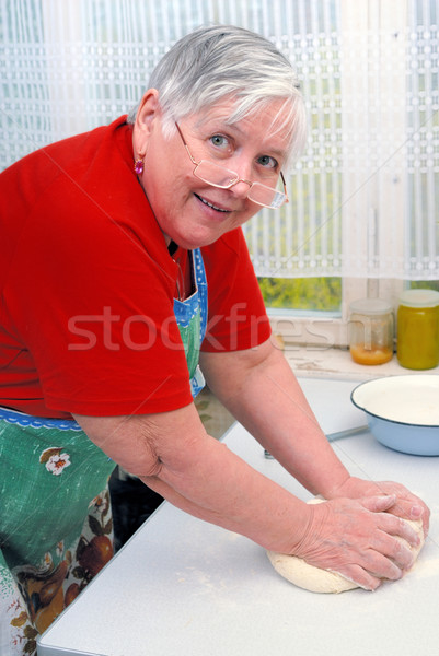 Woman kneading dough Stock photo © mahout