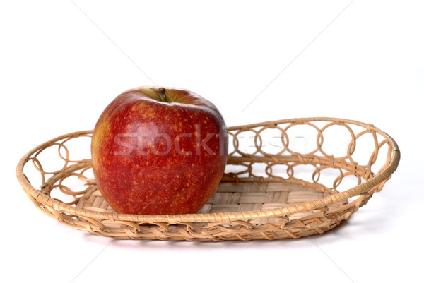 Red apple on wattled plate isolated Stock photo © mahout