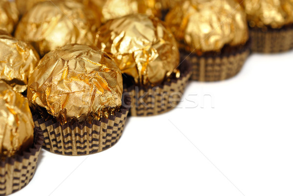 Sweets in wrapper isolated Stock photo © mahout