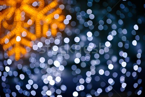 Elmosódott hópehely fények karácsony fény háttér Stock fotó © mahout