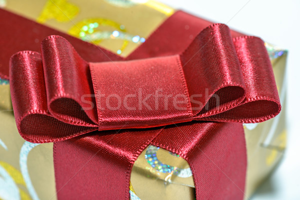 Wrapped gift with red ribbon and bow Stock photo © mahout