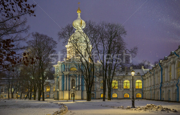 Stock photo: Snowfall and Smolny Convent with night illumination in St. Peter