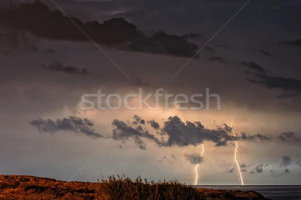 Rayo mar cielo de la noche cielo azul noche Foto stock © mahout