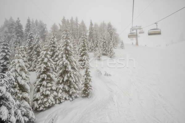 Chairlift in snowfall at alpine ski resort Stock photo © mahout