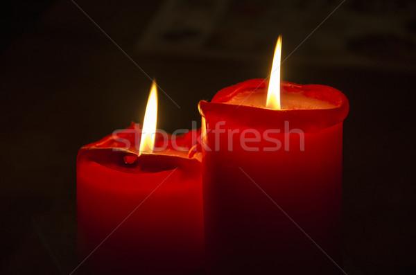 Piros karácsony gyertya gyertyák fekete fény Stock fotó © maisicon