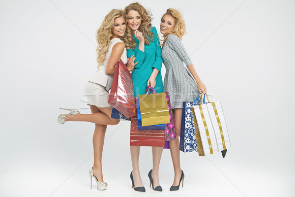 Three alluring women holding shopping bags Stock photo © majdansky