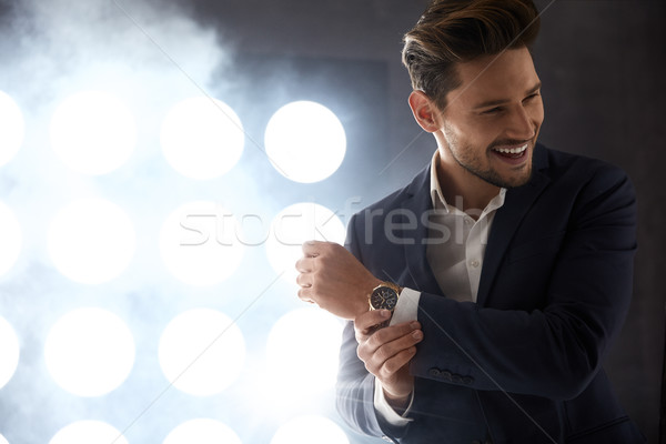 Cheerful young man in the night club Stock photo © majdansky