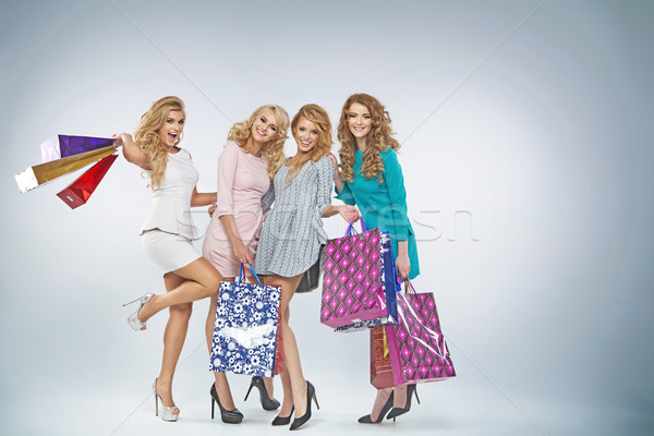 Four charming ladies with plenty shopping bags Stock photo © majdansky