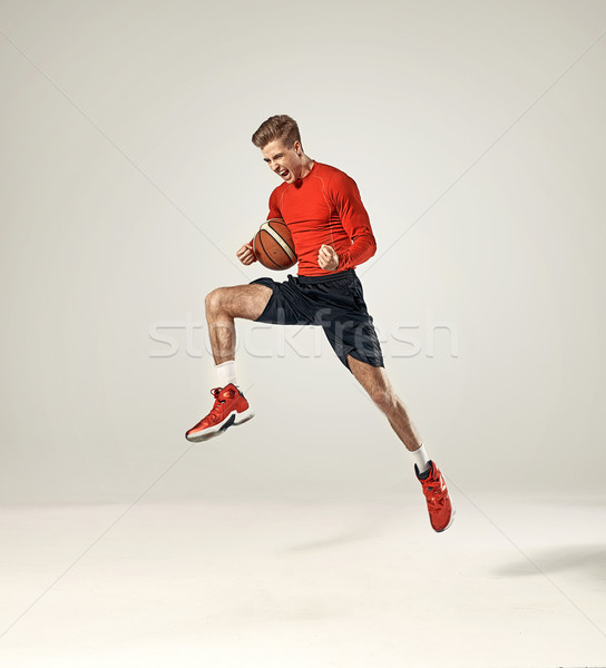 Basketball player holding a ball Stock photo © majdansky