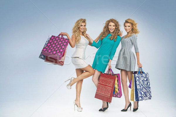 Group of cheerful women enjoying sales Stock photo © majdansky