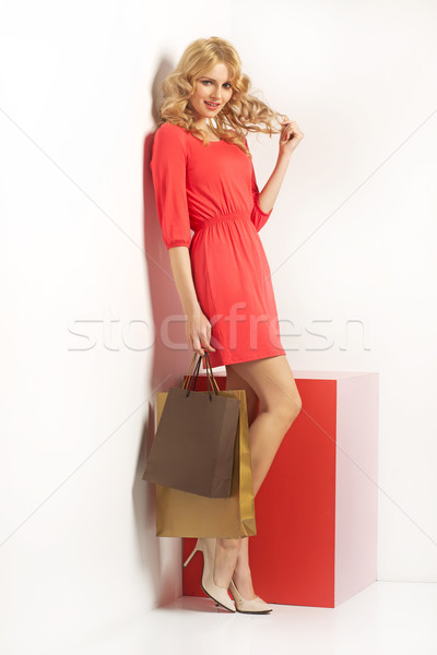 Shy, attractive lady with the shopping bags Stock photo © majdansky