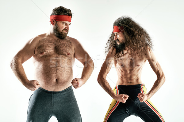 Funny picture of two silly antagonist opponents Stock photo © majdansky