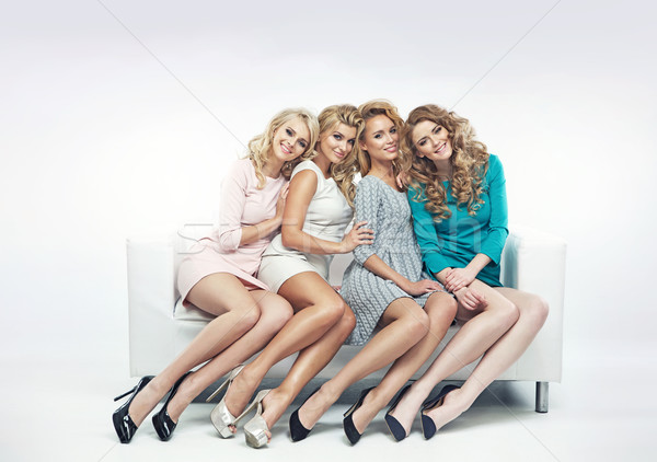 Alluring women sitting on the sofa Stock photo © majdansky
