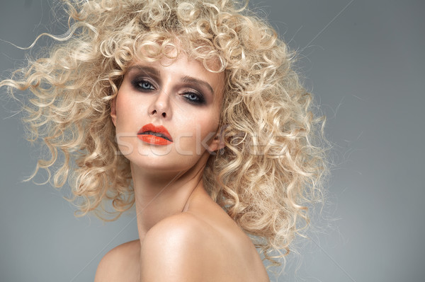 Beautiful blond lady with gorgeous curly coiffure Stock photo © majdansky