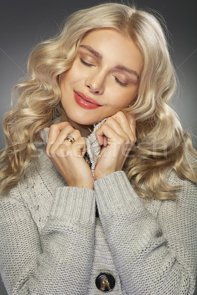 Woman wearing trendy thick sweater Stock photo © majdansky