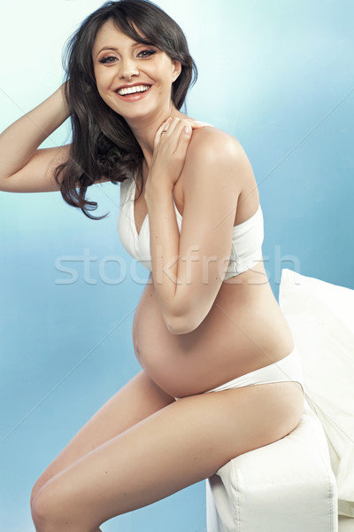 Laughing pregnant woman with fabulous hairstyle Stock photo © majdansky