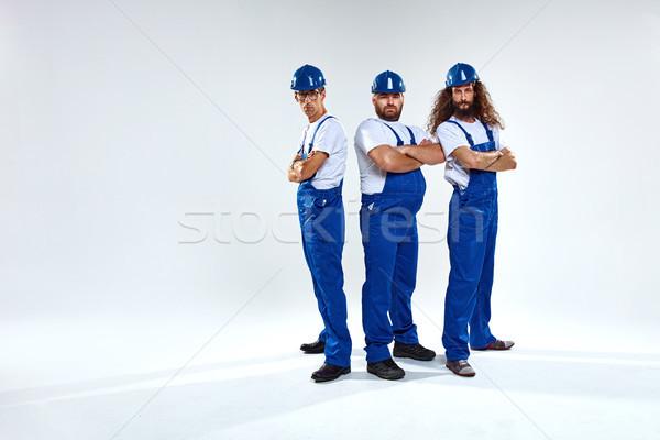 Portrait of three craftsmen ready to work Stock photo © majdansky
