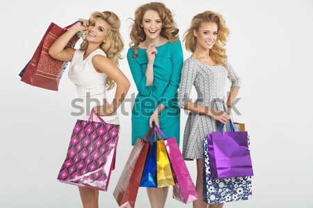 Group of cheerful girlfriends advertising shopping sales Stock photo © majdansky