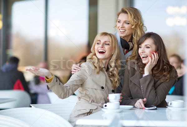 Laughing friends in the cofee shop Stock photo © majdansky