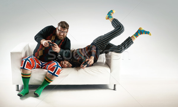 Funny portrait of two friends playing console Stock photo © majdansky
