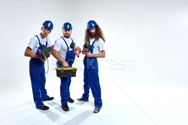 Groupe jeunes travail constructeurs isolé drôle Photo stock © majdansky
