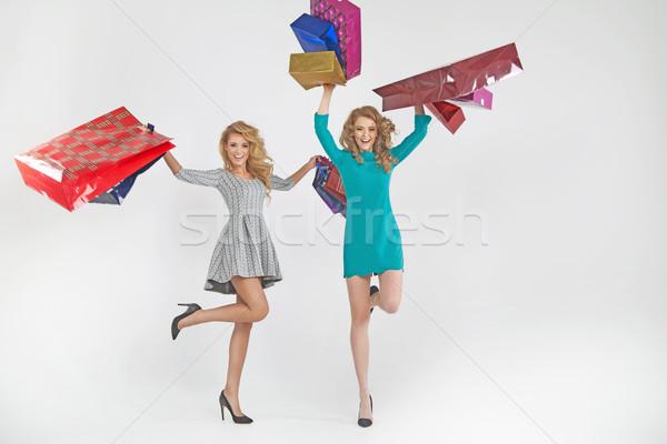 Twee aanbiddelijk vrouwen kleurrijk glimlach Stockfoto © majdansky