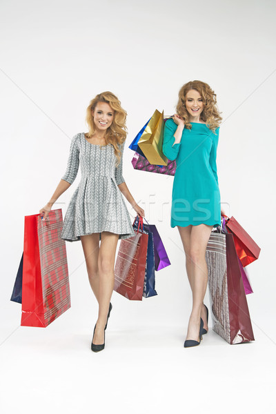 Two charming ladies with plenty of shopping bags Stock photo © majdansky