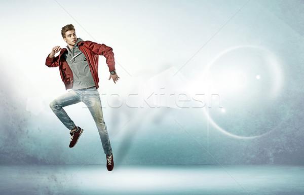 Portre genç atlama hava genç adam Stok fotoğraf © majdansky