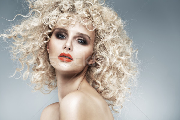 Beautiful blonde with a quaint curly haircut Stock photo © majdansky
