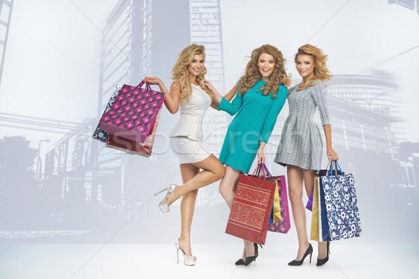 Three attractive blond ladies on sale shopping Stock photo © majdansky