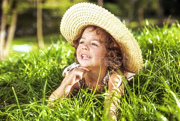 Cute little girl laying on the fresh, summer lawn Stock photo © majdansky