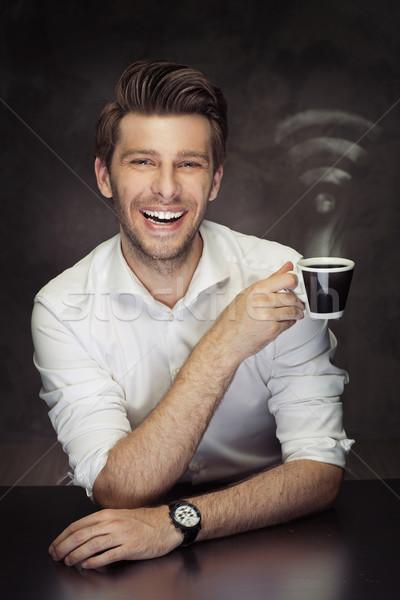 Bild Mann halten Tasse wifi Dampf Stock foto © majdansky