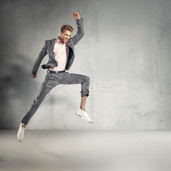Trendi elegáns fickó ugrik levegő férfi Stock fotó © majdansky