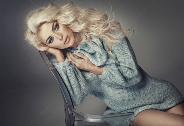 Alluring blonde sitting on the crystal chair Stock photo © majdansky
